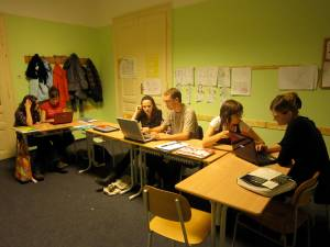Advanced-level students using laptops to produce film reviews
