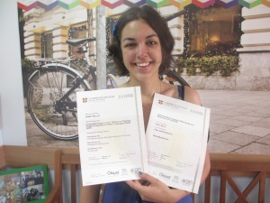 Sandy holding her Delta certificates