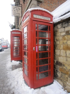 Red phone boxes in the snow
