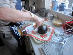 Pouring brandy on the Christmas pudding