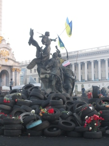 Statues holding Ukraine flags
