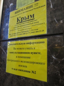 A sign in Kiev train station, offering help with accommodation and 'life needs' to Crimeans in the city