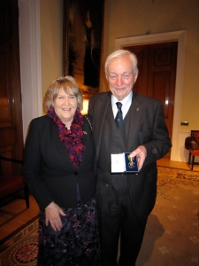 Len Holder with his wife Ann, after receiving the Merchant Navy Medal, November 2012