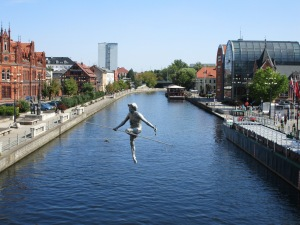View from Kaminskiego bridge - sculpture of a man on a trapeze wire over the River Brda