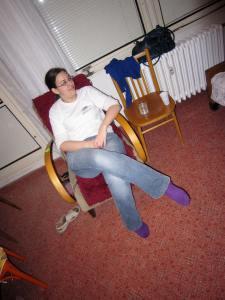 Sandy sitting in an armchair