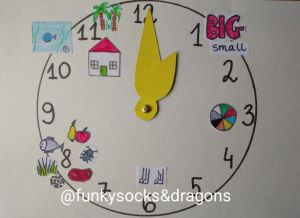 A paper clock with moveable hands showing (at different times) big and small, a colour wheel, food icons, a house/a fish tank/trees